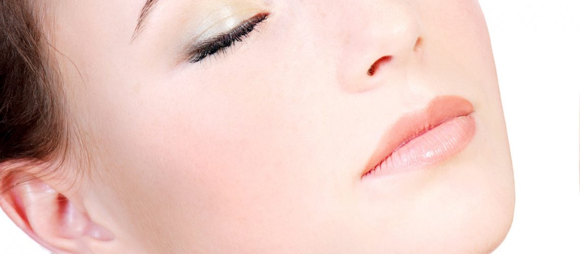 Young woman face close-up with closed eyes, Relaxation concept.